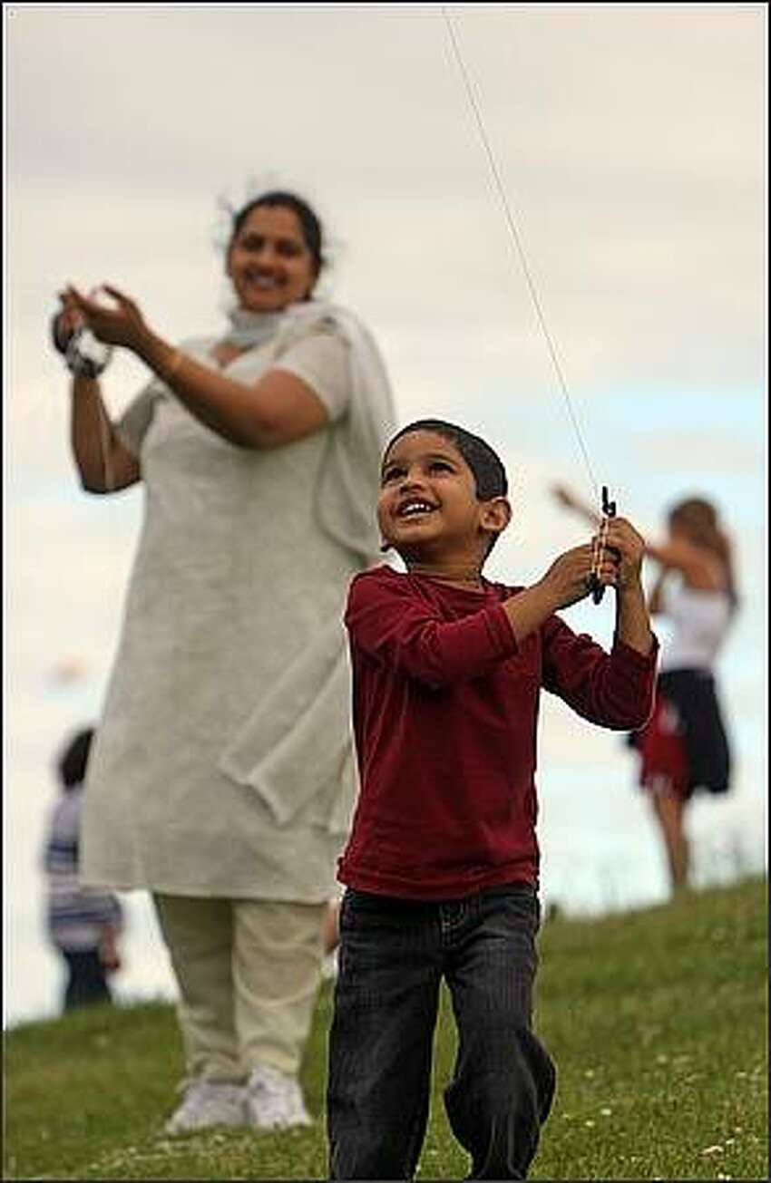 Sanjay Javvadi, 3, of Mercer Island, flies a kite before the fireworks show at Gas Works Park in Seattle on the Fourth of July. He was there with his parents.
