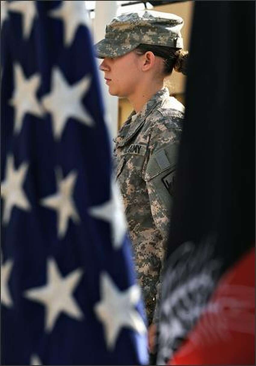 U.S. soldiers attends a ceremony for Veterans Day at Camp Eggers in Kabul on Tuesday.