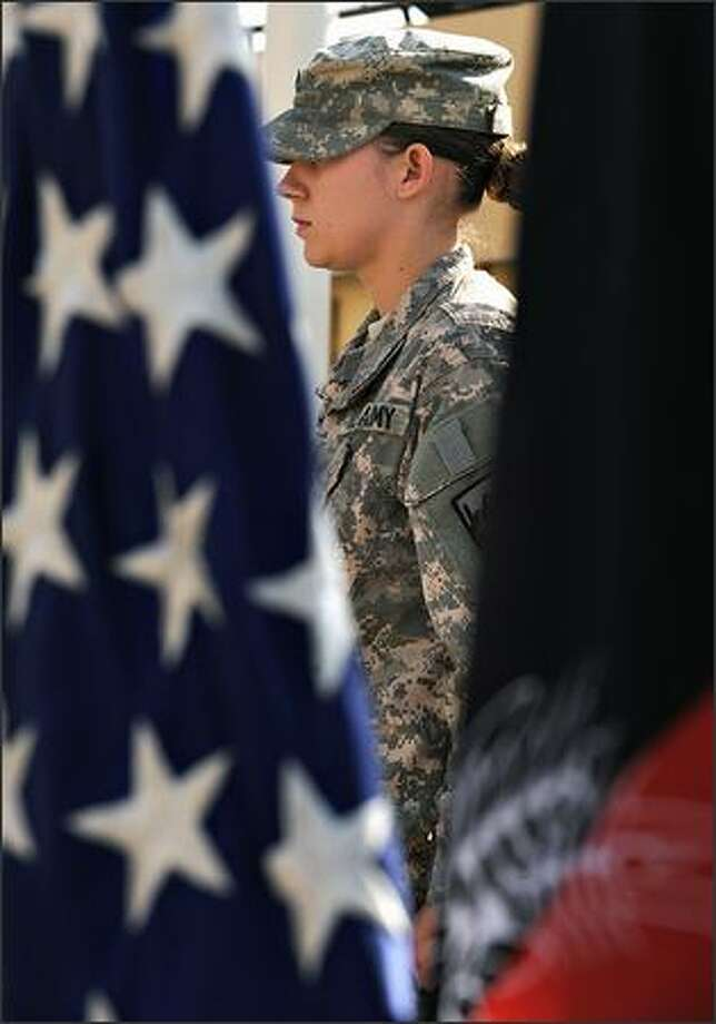 U.S. soldiers attends a ceremony for Veterans Day at Camp Eggers in Kabul on Tuesday. Photo: Getty Images