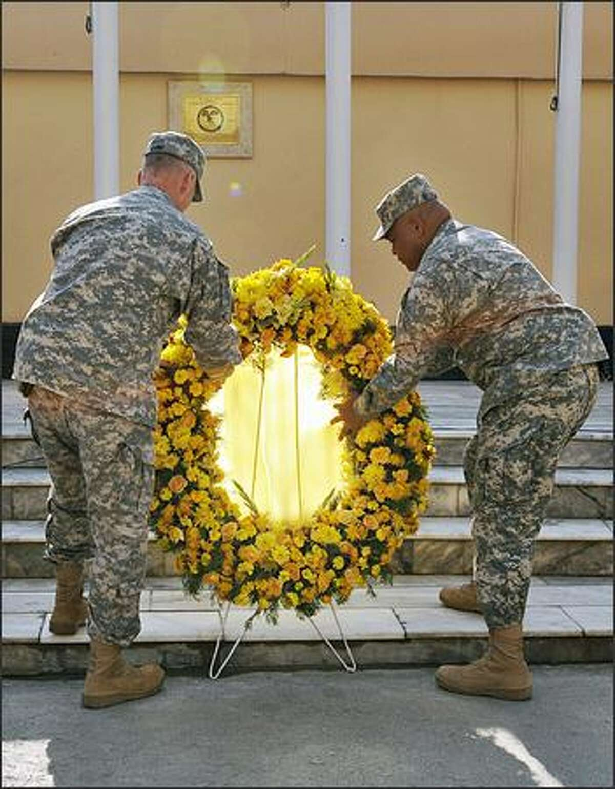 U.S. soldiers lay a wreath during a ceremony for Veterans Day at Camp Eggers in Kabul on Tuesday.