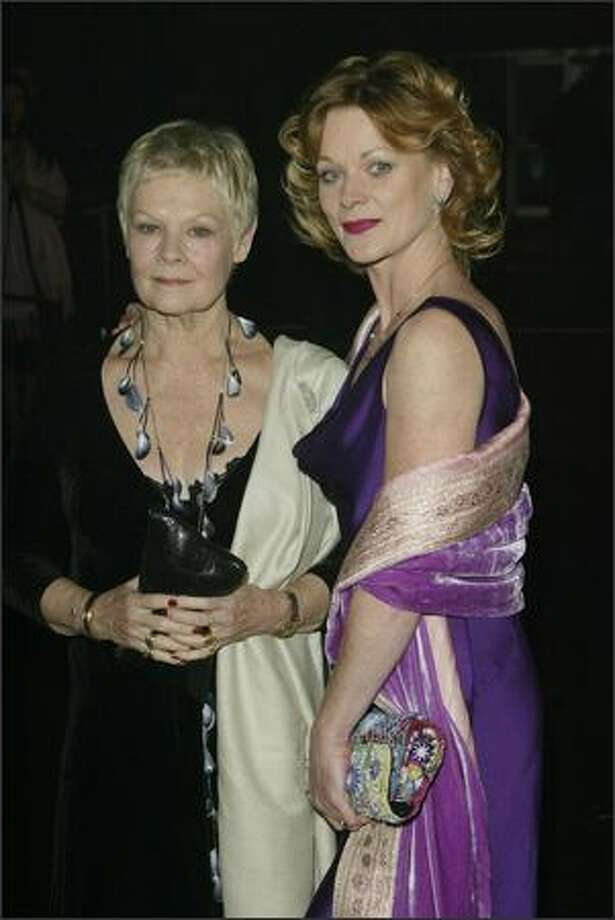 """Actresses Dame Judi Dench and Samantha Bond at the after party for the World Premiere of the James Bond movie """"Die Another Day"""" held in the """"Bond Marquee"""" in Kensington Gardens, London, on November 18, 2002. Judi plays the role of """"M"""" and Samantha plays """"Miss Moneypenny"""" in the movie. (Getty Images)"""