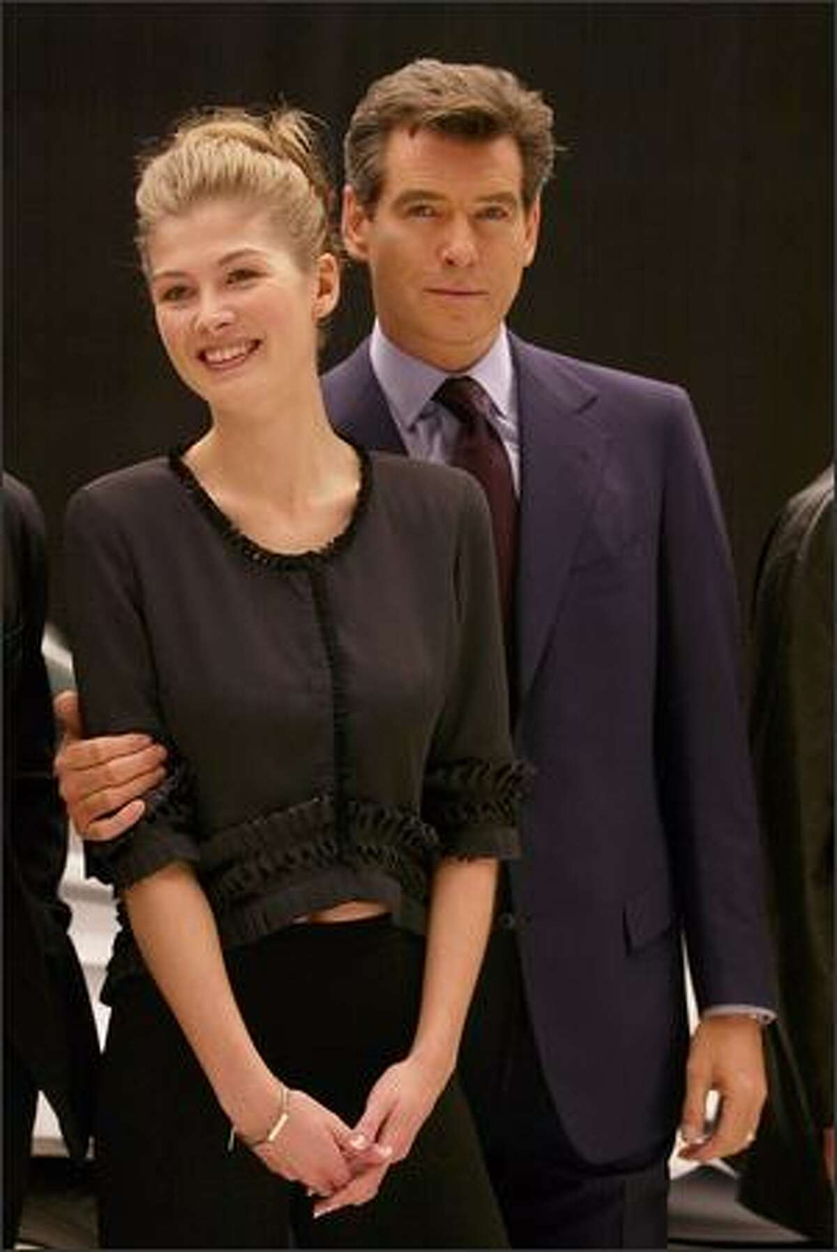 Rosamund Pike and Pierce Brosnan at Pinewood Studios, England, for the launch of