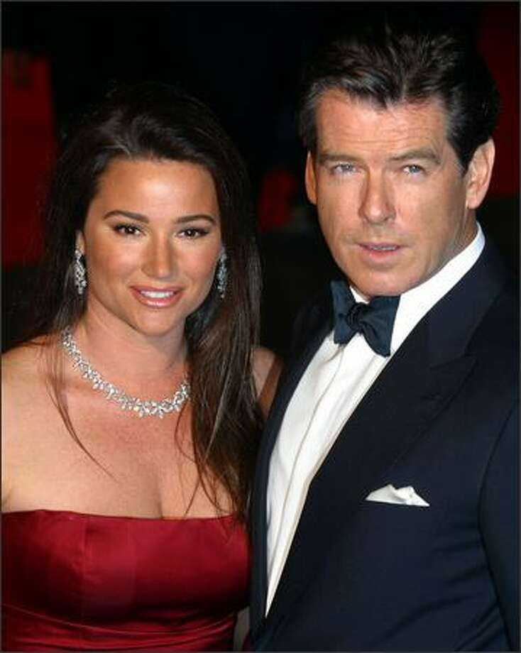 "Pierce Brosnan and his wife Keely arrive at the world premiere of the 20th James Bond film ""Die Another Day"" on November 18, 2002 at the Royal Albert Hall in London. Photo: Getty Images"