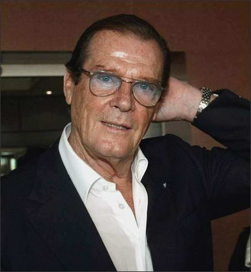 Former James Bond actor Sir Roger Moore gestures as he arrives on October 26, 2003 at Hanoi's airport as a goodwill ambassador for the United Nations Children's Funds (UNICEF). Photo: Getty Images