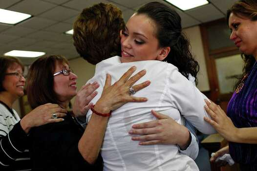 Domonique Ramirez, 17, embraces her grandmother, Josephine Briseño, at the Bexar County Courthouse as they are surrounded by Ramirez's aunts (from left) Mary Alice Briseño and Helen Rodriguez, and Ramirez's mother, Lorena Briseño (right), after the jury found it was the Miss Bexar County Organization, Inc., not Ramirez, that breached contract on Thursday, March 24, 2011. Photo: Lisa Krantz/Express-News / SAN ANTONIO EXPRESS-NEWS