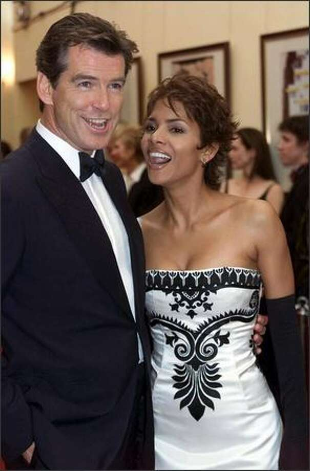 Irish actor Pierce Brosnan and academy-winner Halle Berry arrive for premiere of the James Bond film 'Die Another Day' at the Royal Albert Hall in central London, November 18, 2002. Photo: Getty Images