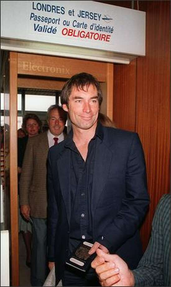 "British actor Timothy Dalton arrives September 5, 1987 at Deauville airport to present his 007 movie ""The Living Daylights"". Photo: Getty Images"