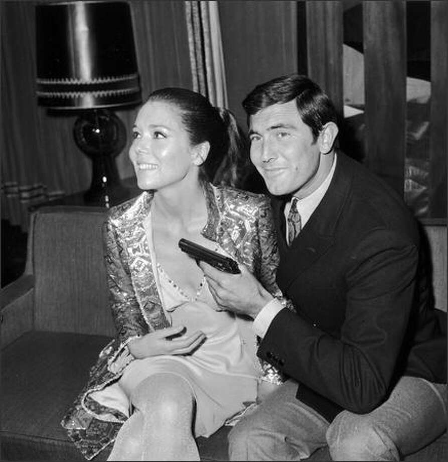 Actor George Lazenby with actress Diana Rigg during a press conference for the James Bond film 'On Her Majesty's Secret Service' in London on October 14, 1968. Photo: Getty Images