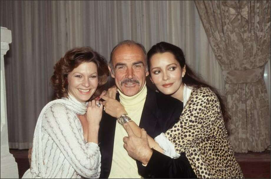 1983: From left to right, Pamela Salem who appears as Miss Moneypenny in 'Never Say Never Again', Sean Connery who plays James Bond and Barbara Carrera who plays Fatima Blush. Photo: Getty Images