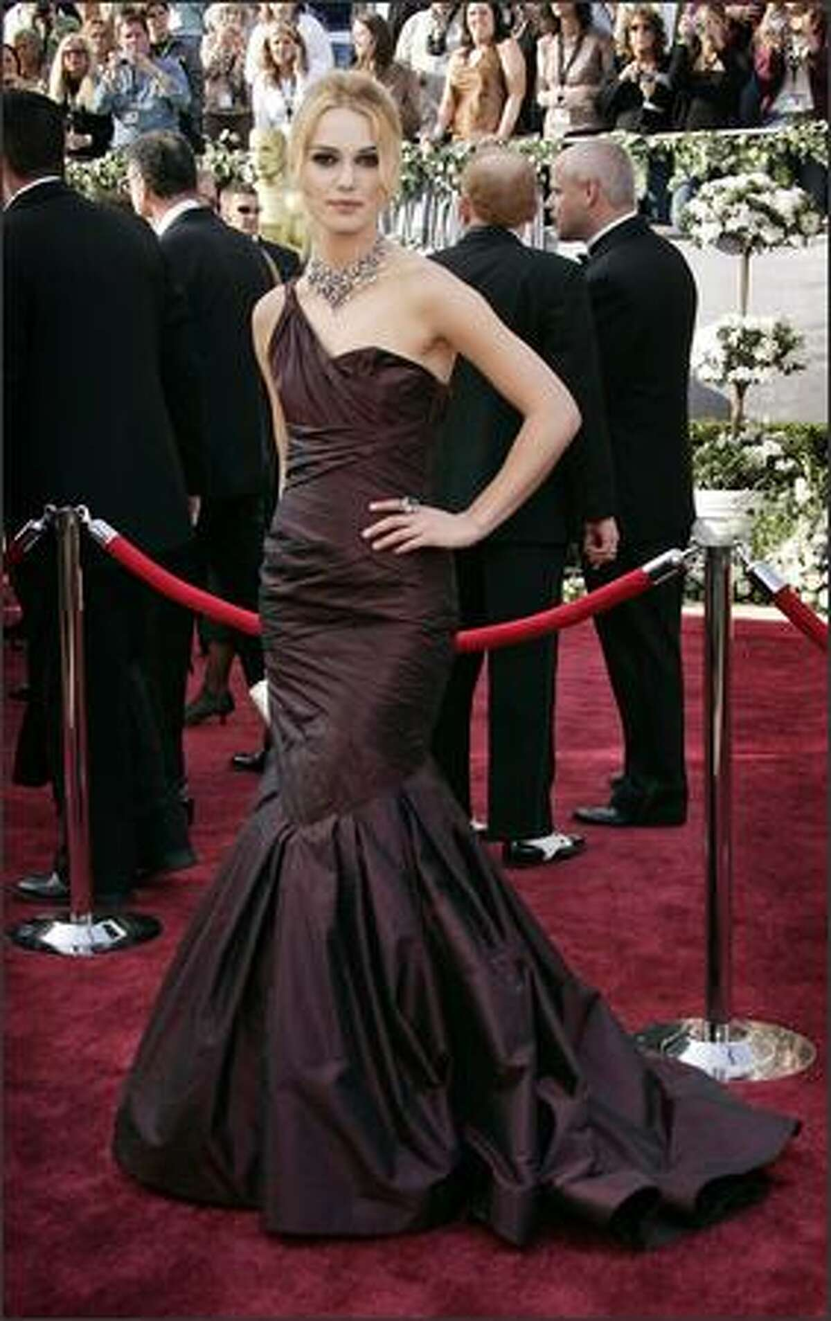"""British actress Keira Knightley, nominated for an Oscar for best actress in a leading role for her work in """"Pride & Prejudice,"""" arrives for the 78th Academy Awards Sunday, March 5, 2006, in Los Angeles. (AP Photo/Kevork Djansezian)"""
