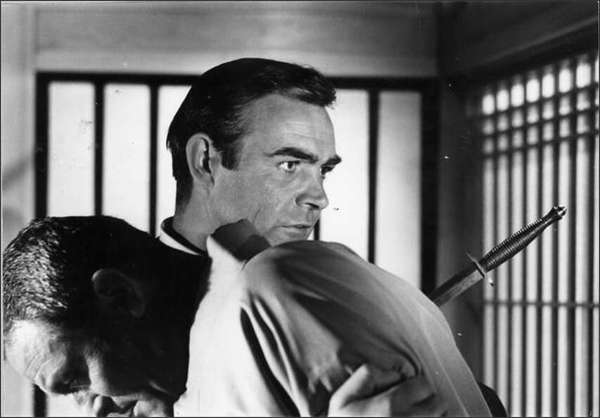 1966: James Bond, played by Sean Connery, discovers the murdered corpse of his contact, played by Ch
