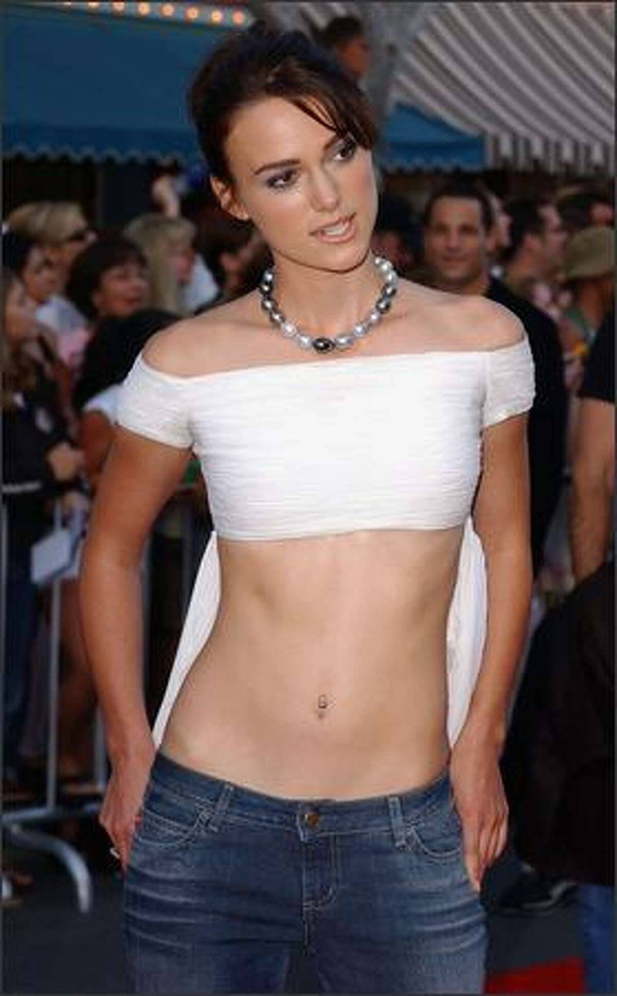"""Actress Keira Knightley arrives at the World Premiere of """"Pirates of the Caribbean: The Curse of the Black Pearl"""" on June 28, 2003, at Disneyland in Anaheim, California. (Photo by Amanda Edwards/Getty Images)"""