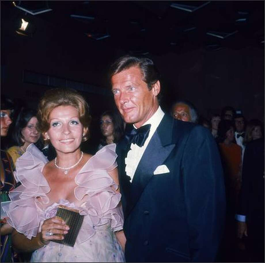 English actor Roger Moore with his wife Luisa Mattioli at the premiere of the James Bond film 'Live and Let Die', directed by Guy Hamilton, London, July 5, 1973. Photo: Getty Images