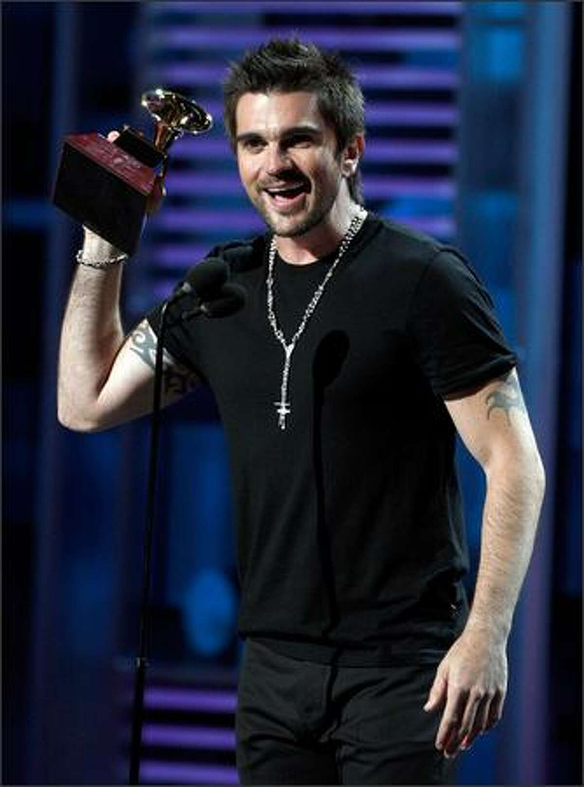 Singer Juanes accepts the Best Male Pop Vocal Album award. He also took home awards for Record of the Year, Song of the Year, Album of the Year and Best Short Form Music Video.