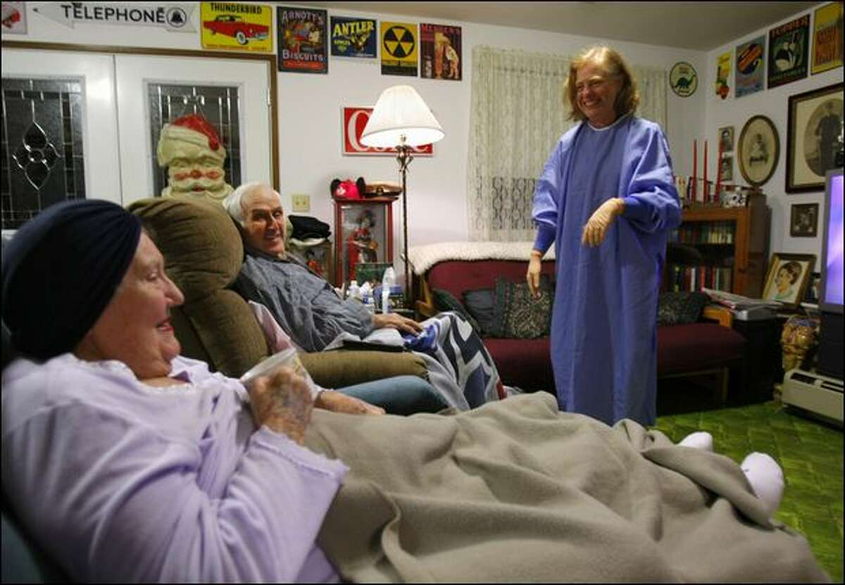 Dr. Patricia Boiko, right, laughs with John and Marjorie Holler during a Friday visit to their Bellevue home. The
