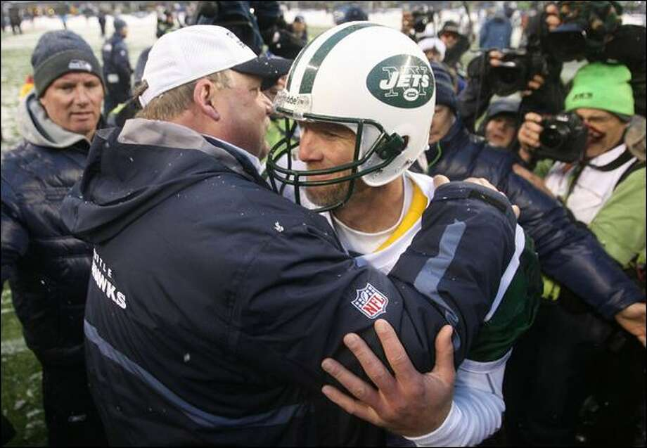 Mike Holmgren and Jets quarterback Brett Favre hug Sunday. Favre, mentored by Holmgren when both were with the Packers, was primarily responsible for ending the Seahawks' previous season in a Green Bay snowstorm. Photo: Scott Eklund/Seattle Post-Intelligencer
