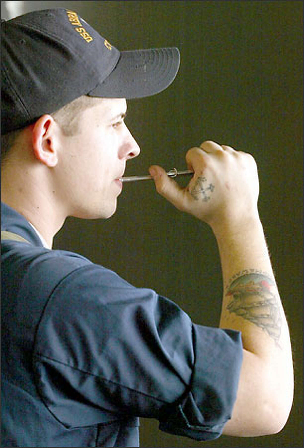 Boatswain's Mate David Slodysko, 25, from Shamokin, Pa. The tradition of pipe