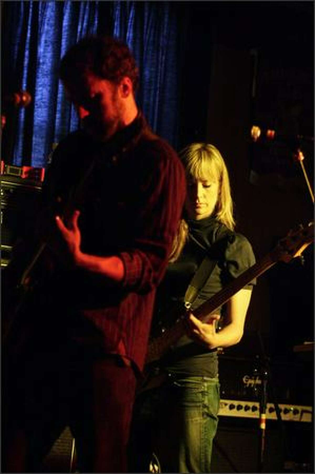 Josh Wackerly, left, and Laura Enderle of Panda & Angel perform at the Salmon Bay Eagles Club.