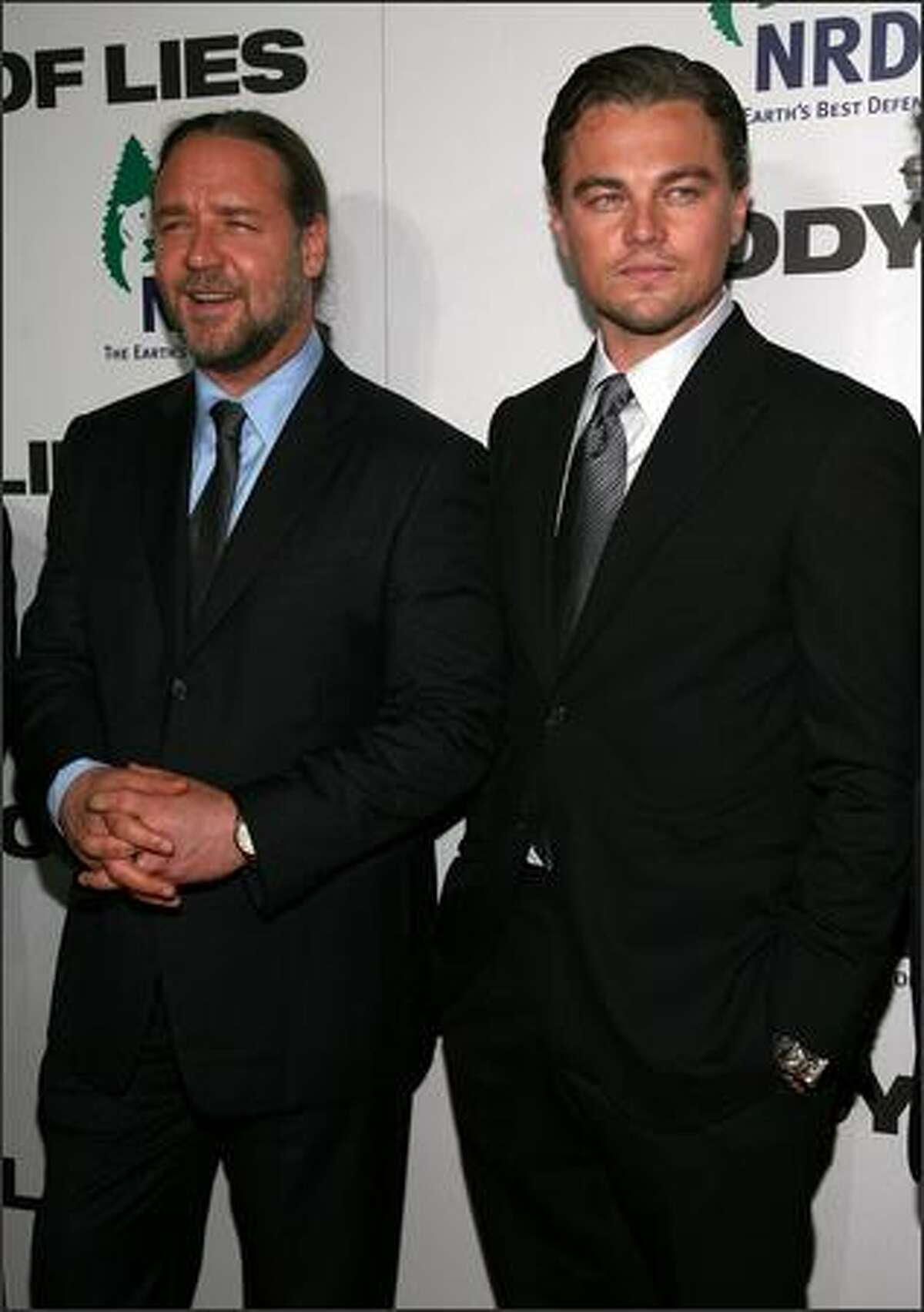 Actors Russell Crowe and Leonardo DiCaprio attend the premiere of