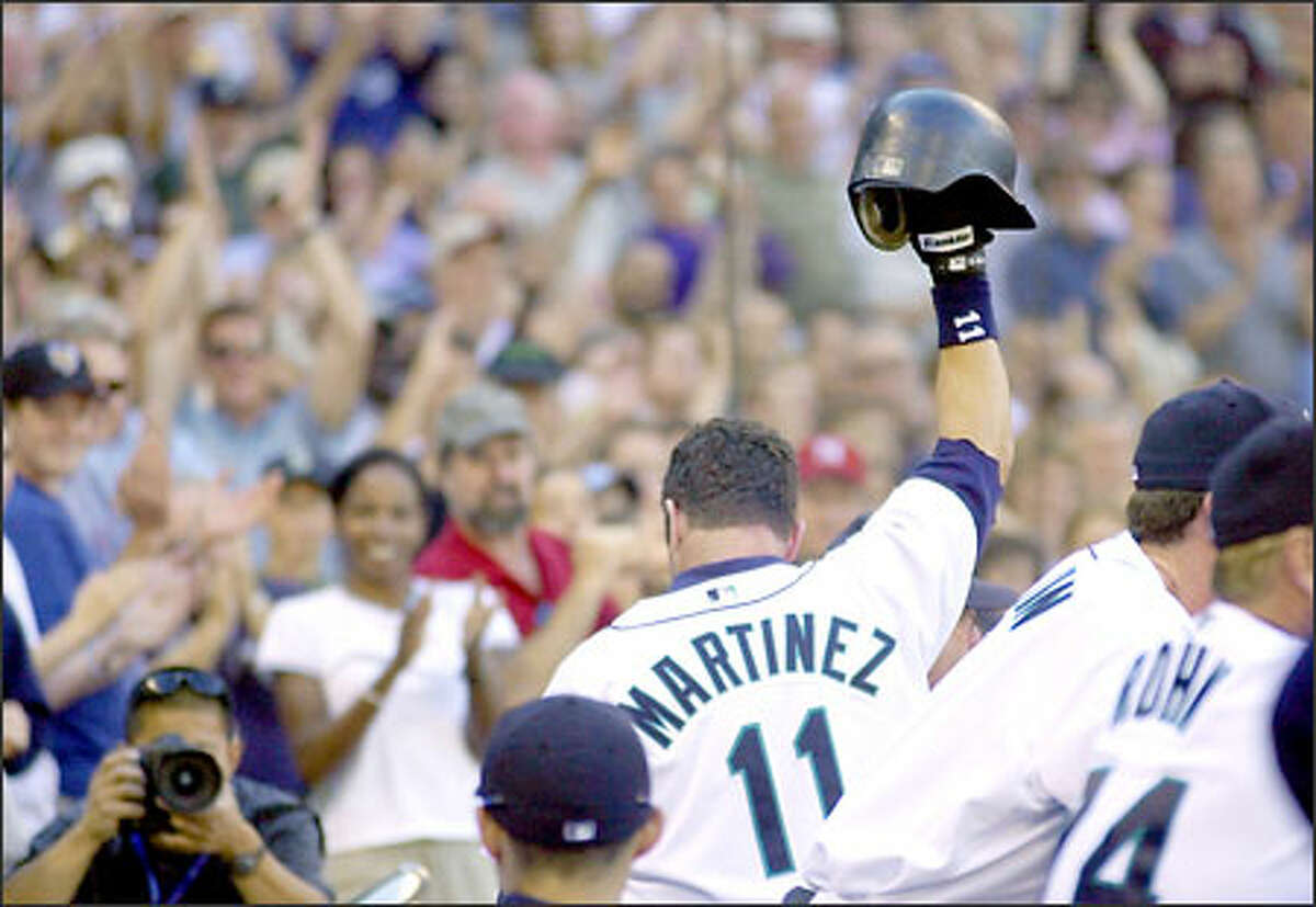 Edgar Martinez acknowledges the cheers from the fans after his final at-bat against the A's. Martinez received a standing ovation before each of his at-bats.