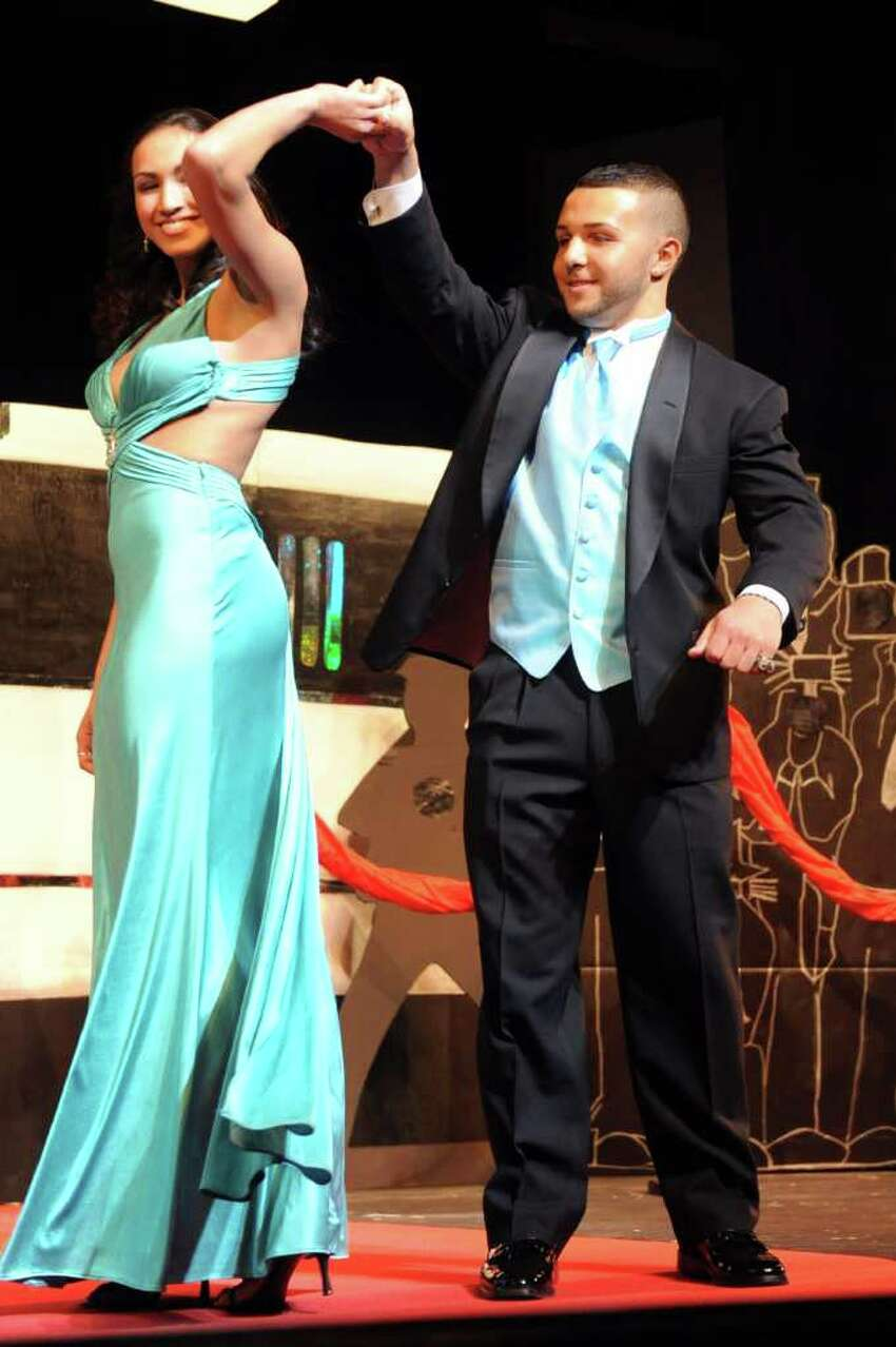 Karissa Reyes and Peter Perimenis walk the runway at a fashion show Thursday, March 24, 2011, at Masuk High School to benefit the school's post-prom event.