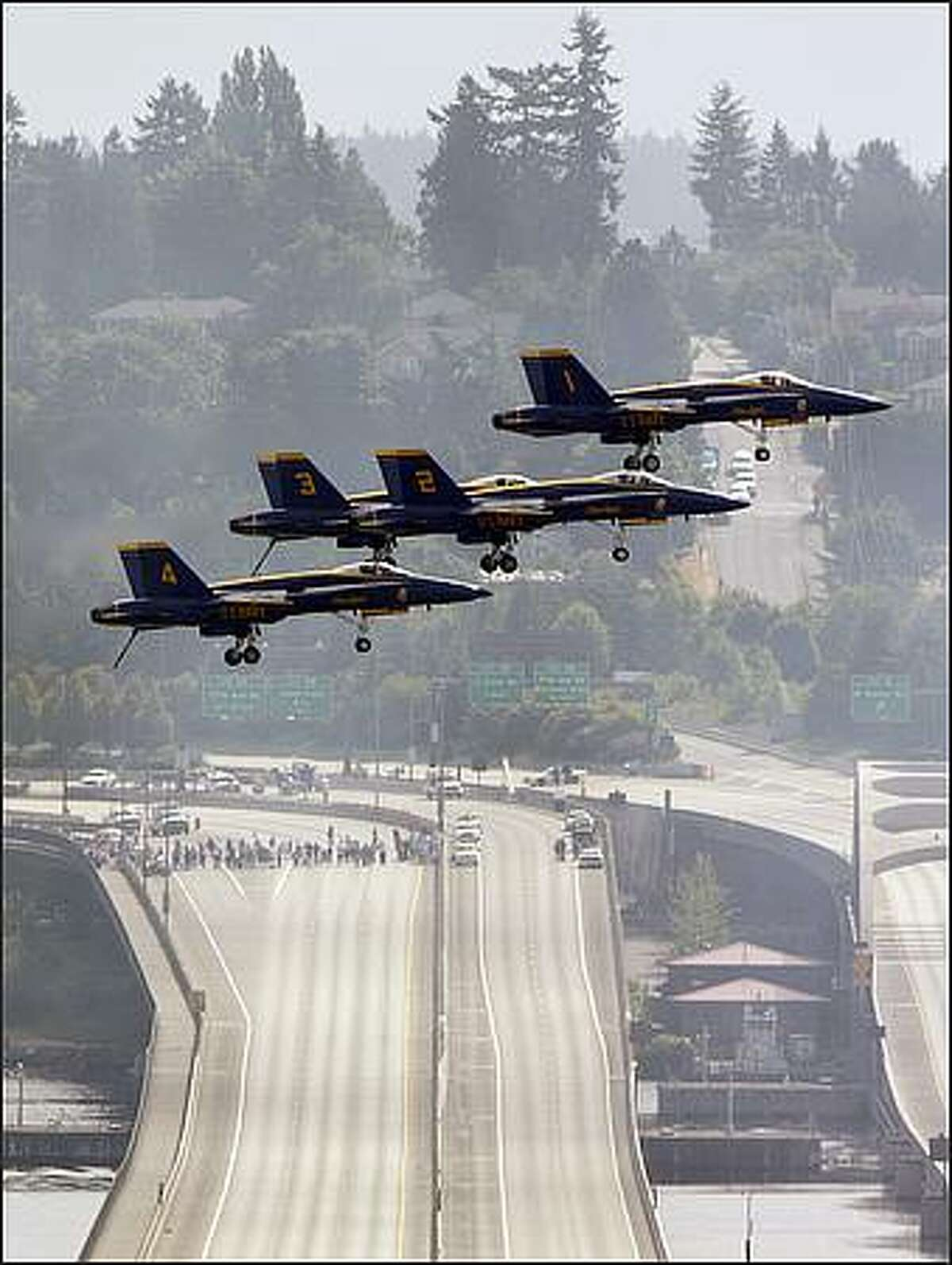Four of the Blue Angels fly over I-90 during a practice flight over Lake Washington.