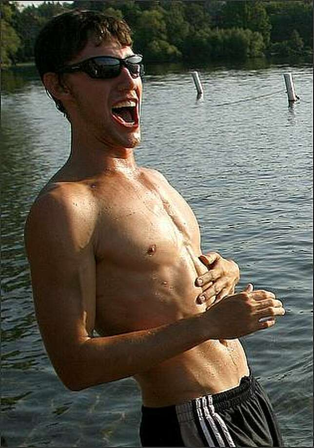 A lifeguard team member enjoys a laugh during the Green Lake Games. Photo: Kristine Paulsen, Seattle Post-Intelligencer