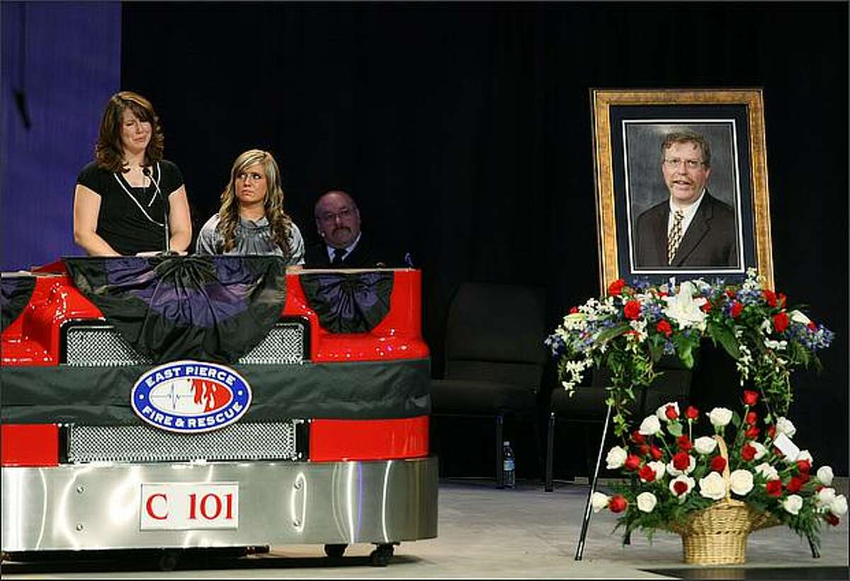 Katrina Packer (left) speaks as her sister Nellie Packer listens at the memorial service for their father, East Pierce Fire and Rescue Fire Chief Dan Packer, who died July 26 fighting a California wildfire. The memorial service for Packer was held Thursday at Christian Faith Center in Federal Way, Wash. Packer, 49 and a Lake Tapps resident, is survived by his wife, four daughters and two grandchildren.