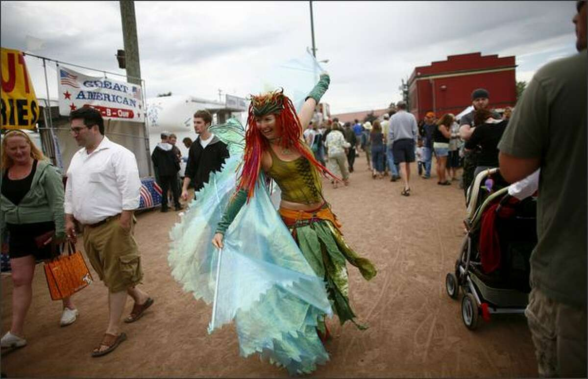 Faerie Cara dances through the crowd during the Taste of Edmonds on Saturday.