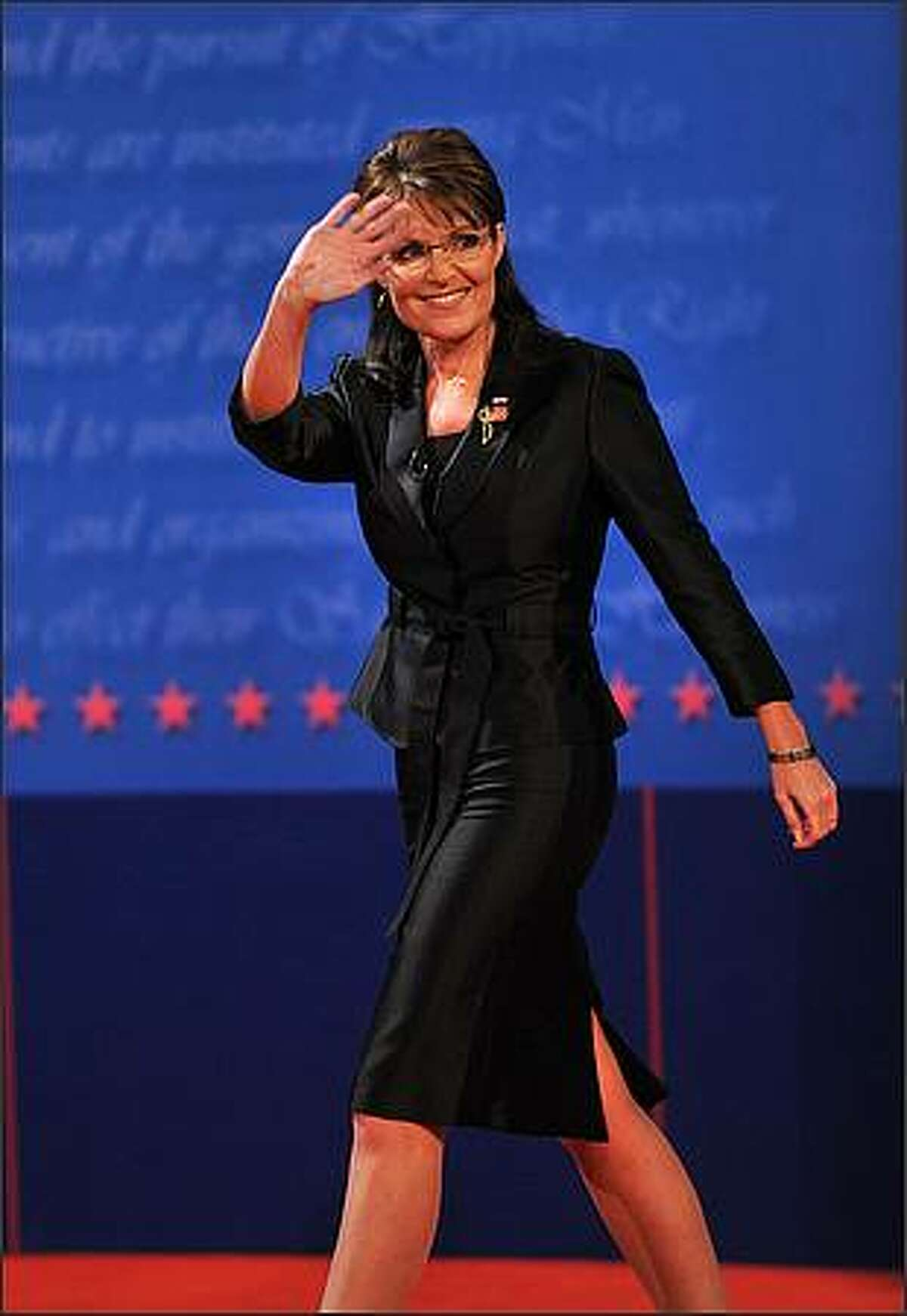 Republican Sarah Palin arrives on stage for her vice presidential debate with Democrat Joseph Biden October 2, 2008 at Washington University in St. Louis, Missouri. (PAUL J. RICHARDS/AFP/Getty Images)
