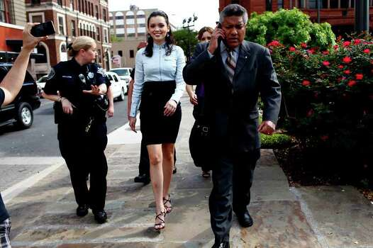 Domonique Ramirez, 17, is escorted by Bexar County Sheriff's Deputies including Chris McLaurin (left) as she leaves the courthouse with her attorney Luis Vera Jr. (right), after a jury found that the Miss Bexar County Organization, Inc., had breached their contract. Judge Barbara Hanson Nellermoe ordered the Miss San Antonio crown returned to Ramirez on Thursday, March 24, 2011. Photo: Lisa Krantz/Express-News / SAN ANTONIO EXPRESS-NEWS