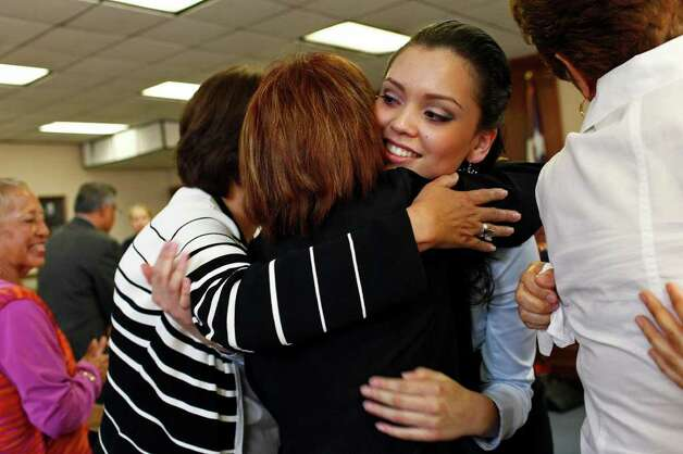 Domonique Ramirez, 17, embraces her aunts, Mary Alice Briseño (left) and Helen Rodriguez at the Bexar County Courthouse after a jury found Thursday that the Miss Bexar County Organization, Inc., not Ramirez, had breached their contract. Photo: Lisa Krantz/Express-News / SAN ANTONIO EXPRESS-NEWS