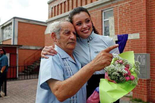 Domonique Ramirez, 17, embraces her grandfather, Agustin Mora, after holding a press conference at Our Lady of Guadalupe Catholic Church after a jury found it was the Miss Bexar County Organization, Inc., not Ramirez, that breached their contract. Judge  Barbara Hanson Nellermoe ordered the crown returned to Ramirez on Thursday, March 24, 2011. Photo: Lisa Krantz/Express-News / SAN ANTONIO EXPRESS-NEWS