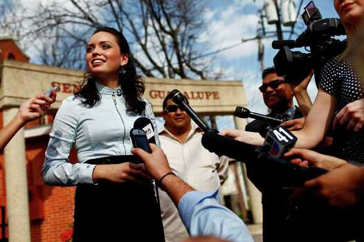 Domonique Ramirez, 17, answers questions from the media during her press conference at Our Lady of Guadalupe Catholic Church after a jury found it was the Miss Bexar County Organization, Inc., not Ramirez, that breached their contract. Judge Barbara Hanson Nellermoe ordered the crown returned to Ramirez on Thursday, March 24, 2011. Photo: Lisa Krantz/Express-News / SAN ANTONIO EXPRESS-NEWS