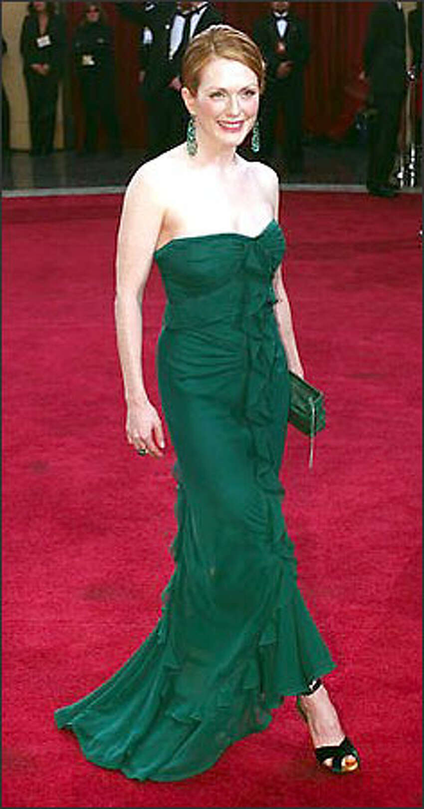 Actress Julianne Moore arrives for the 75th annual Academy Awards Sunday, March 23, 2003, in Los Angeles. Moore is nominated for best actress in a leading role for her work in