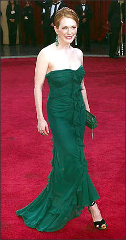 "Actress Julianne Moore arrives for the 75th annual Academy Awards Sunday, March 23, 2003, in Los Angeles. Moore is nominated for best actress in a leading role for her work in ""Far From Heaven"" and best supporting actress for ""The Hours."" Photo: Associated Press"