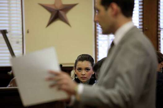 Domonique Ramirez, 17, watches as Attorney Ben Walllis III, co-counsel for the Miss Bexar County Organization, Inc., discusses a question the jury had as the jury deliberates at the Bexar County Courthouse on Thursday, March 24, 2011. Photo: Lisa Krantz/Express-News / SAN ANTONIO EXPRESS-NEWS