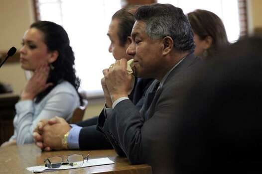 Attorney Luis Vera Jr. reacts as the counts are read where the jury found it was the Miss Bexar County Organization, Inc., not his client, Domonique Ramirez (left), that breached their contract at the Bexar County Courthouse on Thursday, March, 24, 2011. Photo: Lisa Krantz/Express-News / SAN ANTONIO EXPRESS-NEWS