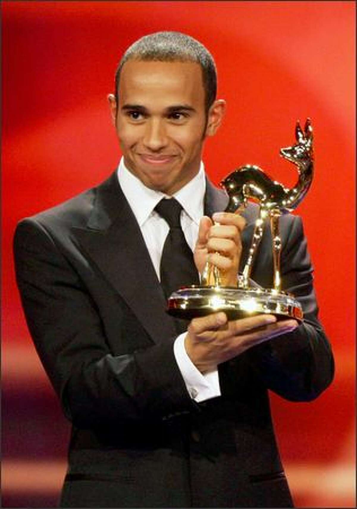 Formula One driver Lewis Hamilton recieves the Special Jury Bambi at the 60th Bambi Awards on Thursday in Offenburg, Germany. The awards ceremony takes place every year under the patronage of German publisher Hubert Burda and awards nominees in the sectors of communication, entertainment and show business as well as economy, politics and sports.