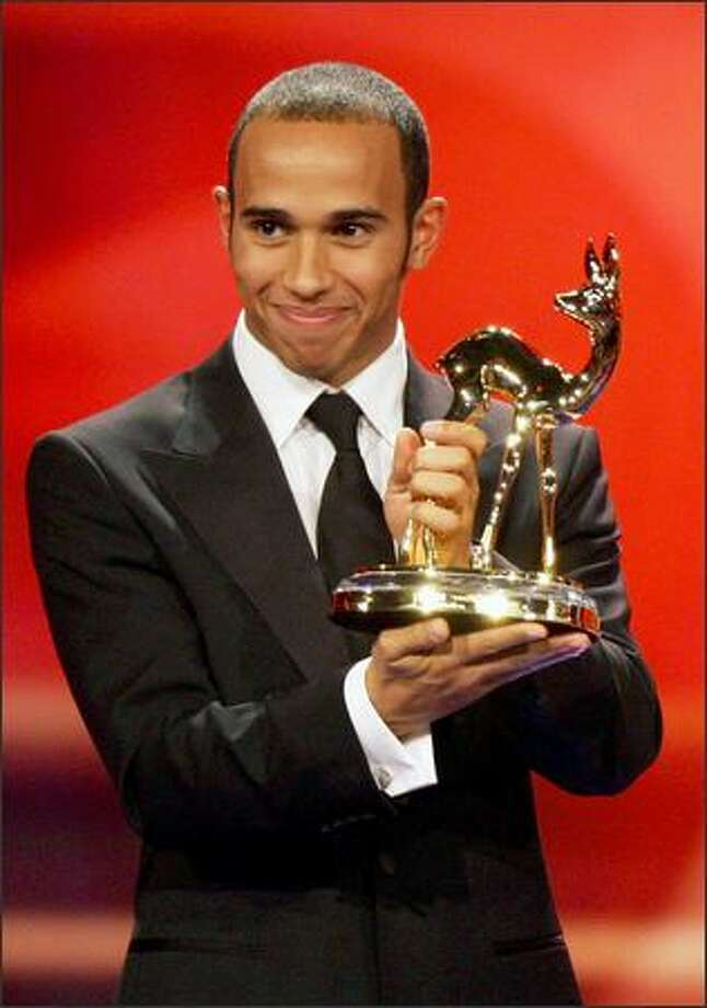 Formula One driver Lewis Hamilton recieves the Special Jury Bambi at the 60th Bambi Awards on Thursday in Offenburg, Germany. The awards ceremony takes place every year under the patronage of German publisher Hubert Burda and awards nominees in the sectors of communication, entertainment and show business as well as economy, politics and sports. Photo: Getty Images