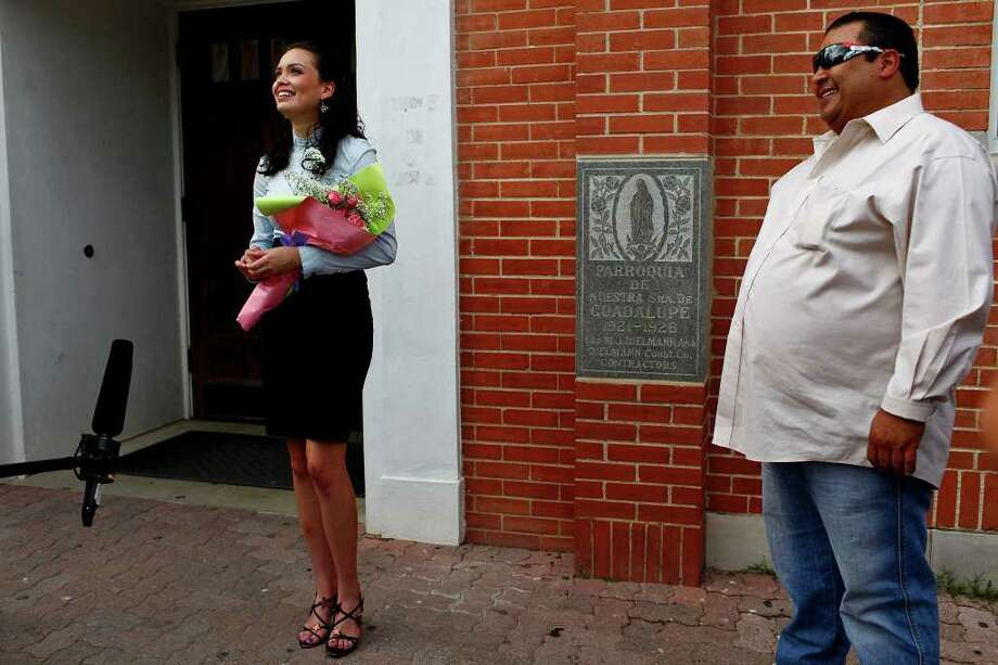 Domonique Ramirez, 17, holds flowers given to her by a friend, as she stands next to Ernest Gonzales after holding a press conference at Our Lady of Guadalupe Catholic Church. A jury found it was the Miss Bexar County Organization, Inc., not Ramirez, that breached their contract, and Judge  Barbara Hanson Nellermoe ordered the crown returned to Ramirez on Thursday, March 24, 2011. Photo: Lisa Krantz/Express-News / SAN ANTONIO EXPRESS-NEWS