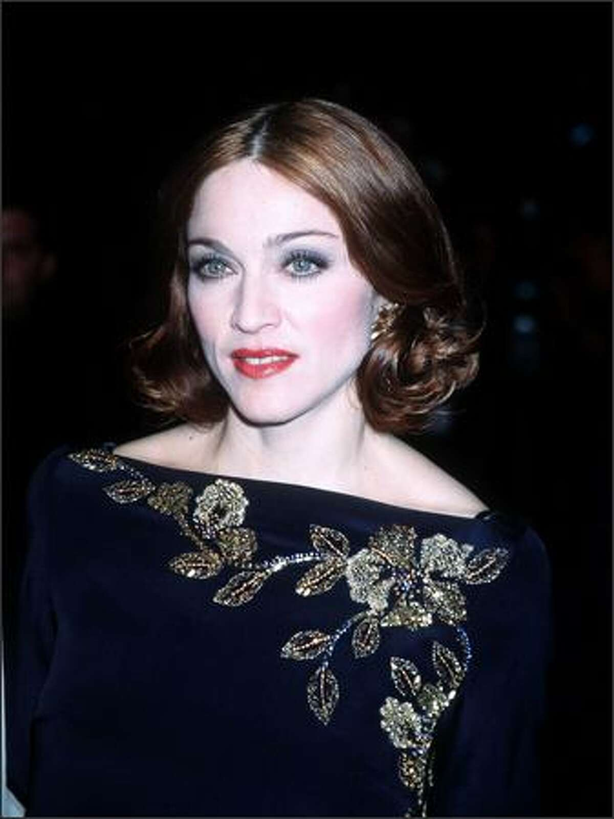 Madonna arrives for a Vanity Fair Oscar Party at Morton's Restaurant in West Hollywood, Calif., March 21, 1999.