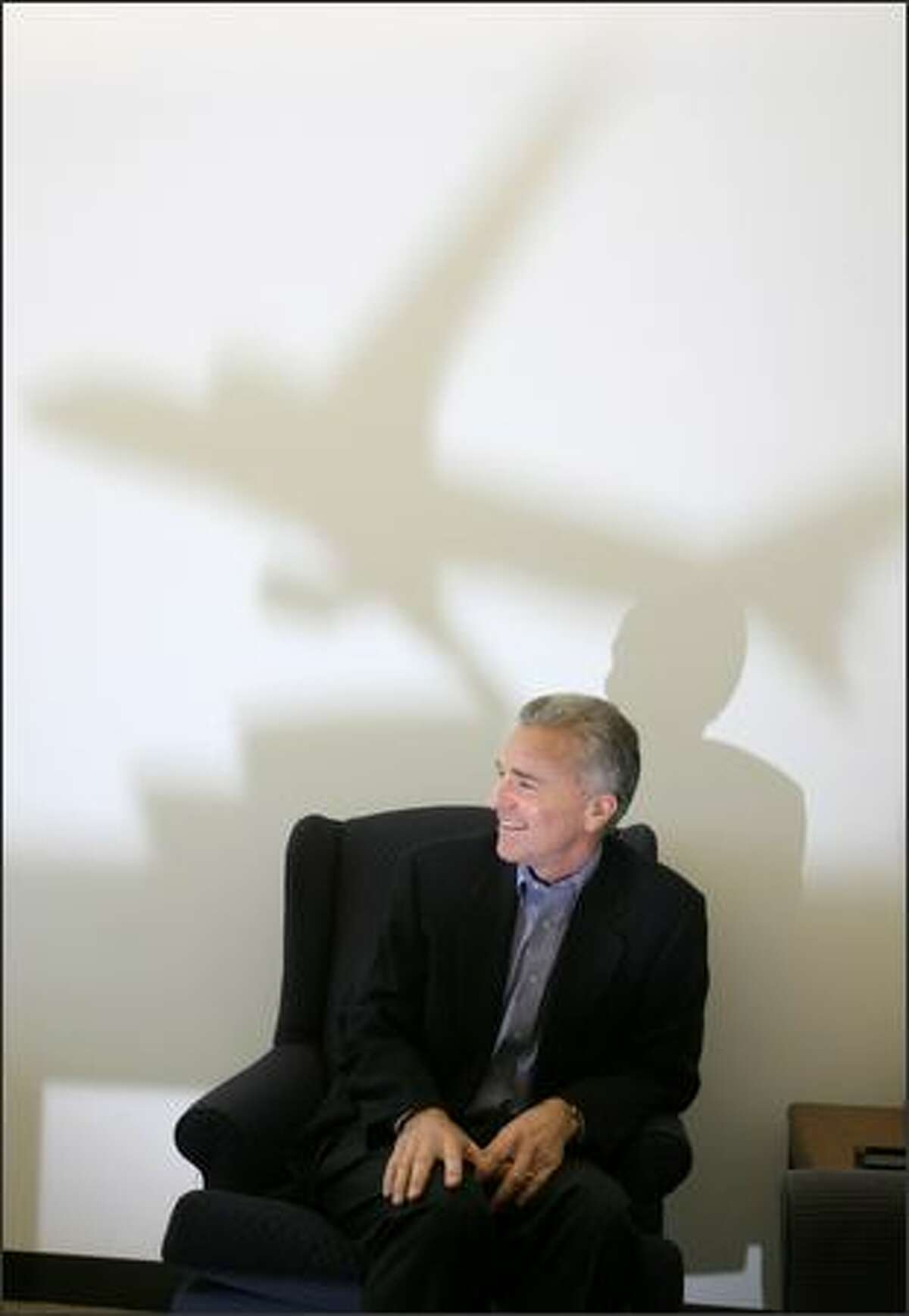 Doug Kight, Boeing's new labor relations chief, is photographed at his Renton office.Eklund: I used a small airplane model on a table and put a flash in front of it to cast the shadow on the wall. Also got some nice light on Kight's face as well.