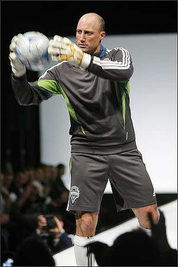 Seattle Sounders FC goalkeeper Kasey Keller wears a dark shale training top and short during a runway fashion show featuring Sounders clothing at the WaMu Theater in Seattle. Photo: Mike Urban, Seattle Post-Intelligencer