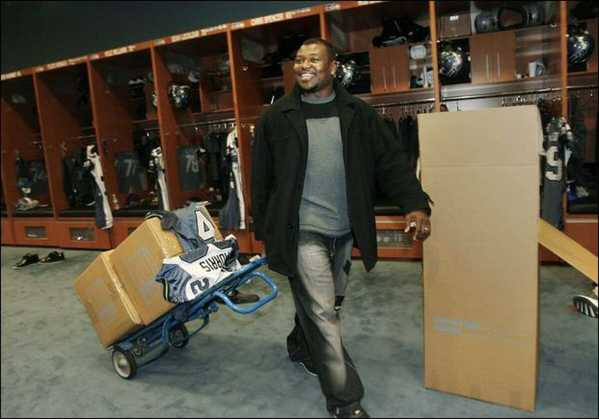 Fullback Leonard Weaver carts his belongings from Seahawks headquarters in Renton. Weaver completed his fourth NFL season with 30 carries, 20 catches and two TDs.