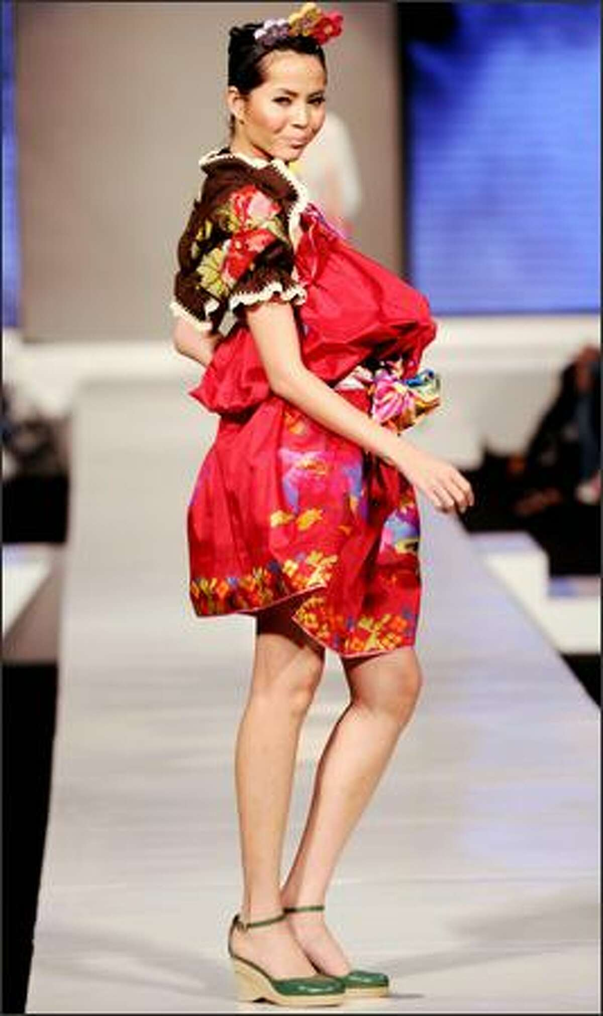 Indonesian models display ethnic outfits during Jakarta Fashion Week 2008, as part of the Jakarta tourism program in Jakarta on Thursday.