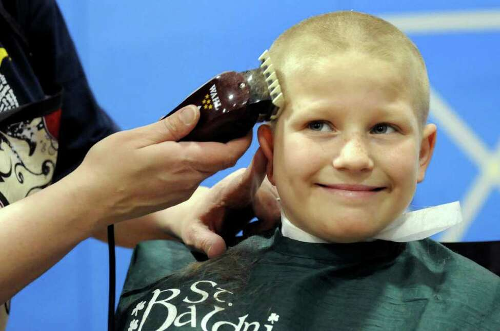 Jeffrey LaMarche, 8, of Watervliet gets his head shaved on Thursday, March 24, 2011, at Latham Ridge Elementary School in Latham, N.Y. Children and adults had their heads shaven to benefit St. Baldrick's Foundation, which gives grants for childhood cancer research. (Cindy Schultz / Times Union)