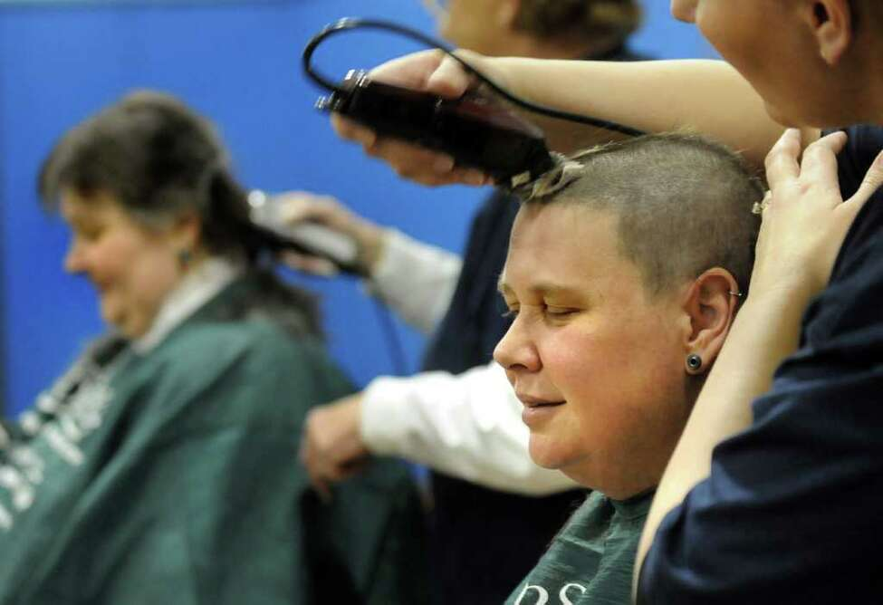 Kelly Dell, right, and her friend Tracie Craig, both of Schenectady gets their heads shaved on Thursday, March 24, 2011, at Latham Ridge Elementary School in Latham, N.Y. Children and adults had their heads shaven to benefit St. Baldrick's Foundation, which gives grants for childhood cancer research. (Cindy Schultz / Times Union)