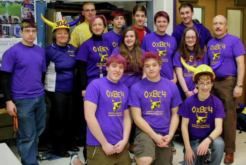 Members of the robotics team from Ballston Spa High School include, from left, back row, Jeff Carminati, Jeremy Hoose, Ryan Gifford and Jared Farrar; middle row, Andrew Campese, Principal Kristi Jensen, Mentor Cindy Van Wyk, Lauren Brady-Haskell, Tom Havens, Claire Freehafer and Mentor Greg Roberts; front row, Jake Torrey, Mike Mahoney and Mike Maiellaro.
