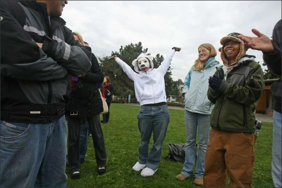Randi Shaw of EarthCorps provides inspiration as a polar bear during a lake plunge at Matthews Beach Park on Lake Washington in Seattle on Saturday, International Climate Action Day. In partnership with Steven Kazlowski, a professional wildlife photographer whose exhibit is on display at the UW's Burke Museum, EarthCorps hosted the Polar Bear Plunge to bring attention to environmental issues and to the UN Climate Change Conference taking place in Poland.